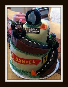monster jam cake. This would be awesome for Cooper's birthday!  But too expensive, I'm doing cupcakes...