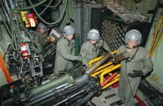 """US Air Force (USAF) aircrew members onboard a USAF Hercules """"Spooky"""" Gunship, Special Operations Squadron (SOS), Hurlburt Field (FLD), Florida (FL), load the Bofors gun (rear) and Howitzer in the cargo compartment during a training mission. Military Weapons, Military Aircraft, Hellenic Army, Air Force Special Operations, C130 Hercules, Ac 130, Close Air Support, Aircraft Photos, Military Photos"""