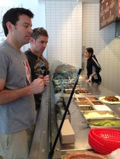 Photo of Ryan and Neil eating at Chipotle for the first time for fans of Ryan Kelly.