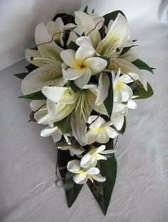 Frangipani & Lily Bouquet, add in pink plumeria and pruple orchid and perfect!