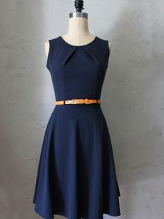 Prim Dress $48 retro inspired fit and flare navy blue dress with modern orange belt