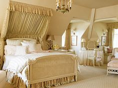 Cream-colored bedroom with slanted canopy over bed.