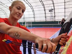 US archer Khatuna Lorig's tattoo is well positioned for photos when drawing her bow.