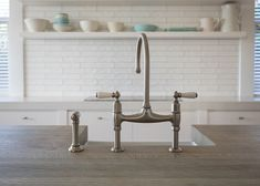The Waiheke Island Cottage featuring Perrin & Rowe Ionian tap with spray rinse. New Zealand Houses, Waiheke Island, Kitchen Taps, Ceiling Beams, Open Shelving, Kitchen Design, Sink, Cottage, Brass