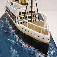 our local restaurant had a titanic theme night to celebrate the anniversary complete with menu from the great ship the night it sank. They wanted a really special centerpiece so we created this Titanic cake for them the whole thing is. Titanic Cake, Cake Decorating Techniques, Cake Decorating Tutorials, Gala Dinner, Unique Cakes, Creative Cakes, Rodjendanske Torte, Boat Cake, Birthday Cakes