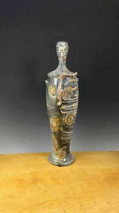 Mark Goertzen. Tall Figurative Vase. Wood-fired White Stoneware. Side fired