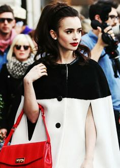 Lily Collins cape coat + red details http://www.luvtolook.net/2013/05/lily-collins-cape-coat-red-details.html
