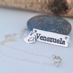 "My Venezuela Necklace come with a tiny heart charm on the right side of the necklace; it has the Venezuelan map stamped on it... It includes ""el esequibo"" as it shold be since we all learned at school that our map looks that way.  I know it does not sound good BUT it is SOOO CUTE!!!! Don't you think?  A unique Christmas present for that Venezuelan friend of yours please Click here to get the My Handmade at Amazon store link @mgdcasualjewelry PLUS it is a Prime product so it will ship really…"