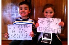 """Geraldine O'Neill: """"Last January I took this photo of my son Hugo and daughter Heidi holding the first scan pic and two placards to announce my pregnancy with their baby brother Harley, who is now three weeks old. I posted the pic on to my Facebook along with sending the pic as a message to family members friends etc to share our good news!"""""""