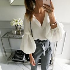 Belted trousers and bell sleeves blouse