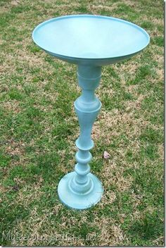 Birdbath - she had a giant old candlestick, and glued the lid of a pot upside down, then spray-painted.  Might add a few spoons to the edges before painting so the birds have a perch.