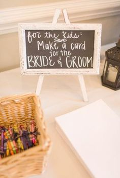 Kids table idea - crayons paper to make a card for the bride groom {Amber Rhodes Photography}
