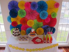 Folded paper wall decor and ruffle cake. Great colorful party ideas
