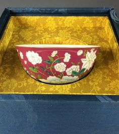 """Rare and important Chinese QianLong Period Imperial Enameled Purple Bowl in Original Box. Simply flat rim and base, exterior and interior vividly hand-painted in enamel design of four seasons flowers against a purple color background. Mark on base, four Seal Scripts -ZhuanShu- Characters enclosed by double squared lines, YongZheng Reign Period of Great Qing; and probably of the period. Bowl, 6-1/2"""" D x 3""""H"""