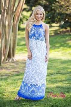 This beautiful maxi dress channels the bright blues and off-white of the Mediterranean coastline! With a high neckline, ruching at the bodice, and a cute fabric tie around the waist, this sleeveless maxi is perfect! We also adore the small keyhole detail in the back with a gold accented button!