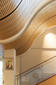 Decor Systems collaborated closely with the Architects to ensure that together we could create a ceiling that is both unique and enhances the libraries acoustics. Timber Wood, Wood Paneling, Libraries, Architects, Stairs, Ceiling, Create, Unique, Projects
