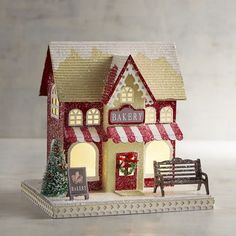 Add a vintage look to your holiday decor with our Christmas village. Its classic red and green design is a holiday delight, from the top of snow-covered roofs and gingerbread trim to the garlands, trees, and LED lights. Christmas Village Collections, Christmas Village Display, Christmas Village Houses, Unique Christmas Decorations, Putz Houses, Christmas Villages, Vintage Christmas Ornaments, Holiday Decor, Christmas Gifts For Women