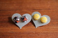 Cute little fabric button earrings. You only need scraps of fabric... I bet we have some sewers who have a few scraps around that might work for these. :)