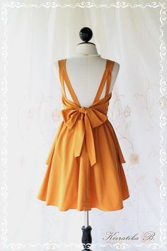 A Party V Shape Style - Cocktail Prom Party Dinner Wedding Night Dress Mustard Yellow Full Lined Deep Back Bow Tie Sexy Charming Looks. $46.30, via Etsy.