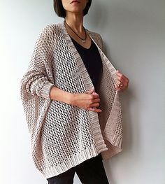 Juxtaposing relaxed silhouette with slender sleeves, Angelina perfectly captures effortless sophistication. This trendy oversized cardigan drapes beautifully into a high-low hemline and is flattering for all body shapes. With ribbed cuffs and borders, Angelina is worked from top down in a simple mesh stitch pattern. This flexible pattern allows you to easily customize the look by adjusting the dimensions of the cardigan.
