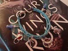 A Court and Thorns and Roses Inspired Metal Charm Bracelet, Summer Court/Tarquin Edition by TheWorldOfFandom on Etsy
