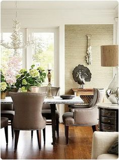 Elegant dining room with white resin Horchow Coral Chandelier, mushroom linen dining chairs with nailhead trim, sand beige grasscloth wallpaper, metal peacock and mercury glass lamp. Elegant Dining Room, Dining Room Design, Dining Area, Dining Table, Dining Rooms, Table Lamp, Linen Dining Chairs, Upholstered Chairs, New England Homes