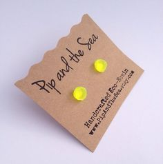 Neon yellow faceted eco-resin earrings. Surgical steel studs.