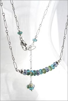 Modern simple necklace with sterling silver chain and faceted glass beads in blue, aqua, green and turquoise.