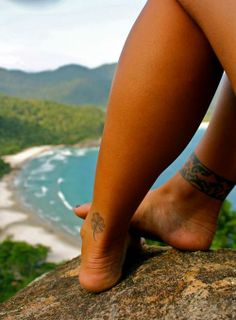 Anklet tattoo <3 and behind the ankle.