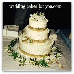 A sweet golden anniversary wedding cake with gold ribbon and dragees by Lorelie@wedding-cakes-for-you.com