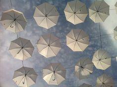 White umbrellas are in the air