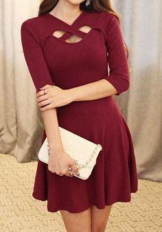 A crop sleeve dress featuring a crisscross cutout at neck.