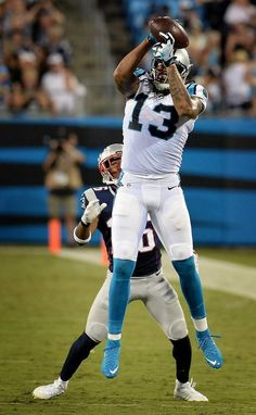 Carolina Panthers wide receiver Kelvin Benjamin leaps into the air to catch a…