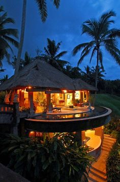 Hawaiian home. I think I see a wrap around crescent pool on the 2nd deck.