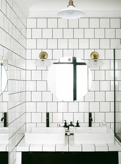 Minimalist living room with square subway tile pairs, brass sconces and minimalist fixtures