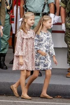 (L) Spanish Princess Leonor and Infanta Sofia attend the military parade of the Spanish national day at Neptuno square in Madrid, Spain.