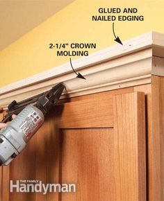 how to add molding to flat cabinet doors - paint same as underneath and braided rope molding  - darker than medium wood color!!! would look AMAZING!!!