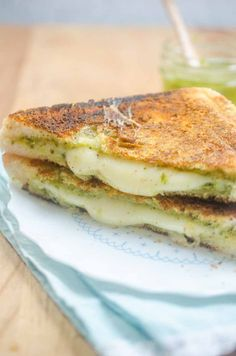 Pesto and Mozzarella sandwiched between Parmesan crusted bread and then grilled to perfection. Pesto Grilled Cheeses, Grilled Ham And Cheese, Grilled Cheese Recipes, Sandwich Recipes, Paninis, Cheese Squares, Wrap Recipes, Yummy Recipes, Healthy Recipes