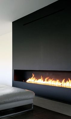 Long, horizontal fireplace in dark wood. Architect unknown ...