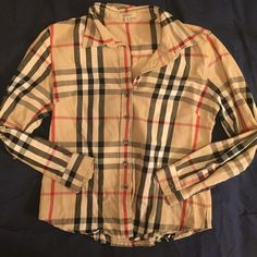 Authentic Burberry Button up Shirt It is a medium size but it runs small. It also has a stain, please refer to the picture. In my opinion is almost unnoticeable. Price reflects the imperfection. Burberry Tops Button Down Shirts