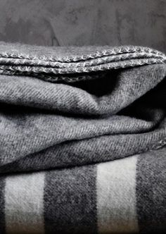 I have a green strip Wool Blanket that belonged to my Grandma.when I wasbyoung and spent the night, she would add one to the topbof my covers just in case.oh how I miss her and spending the night with her and my grandpa too! Textiles, Touch Of Gray, Gray Matters, Going Gray, Fifty Shades Of Grey, Cozy Blankets, Wool Blanket, Warm And Cozy, Grey And White