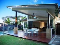 Enclosed outdoor living design with glass balustrade & decorative lighting using grass - Outdoor Living Photo 1314755 Indoor Outdoor Living, Outdoor Living Areas, Outdoor Spaces, Outdoor Decor, Outdoor Dining, Dining Area, Outdoor Furniture, Deck With Pergola, Patio Roof