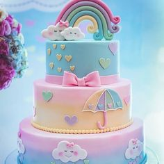 A rainbow cake is fun to look at and eat and a lot easier to make than you might think. Here's a step-by-step guide for how to make a rainbow birthday cake. Baby Cakes, Baby Shower Cakes, Cloud Baby Shower Theme, Cloud Cake, Rainbow Baby, Cake Rainbow, Unicorn Rainbow Cake, Rainbow Pastel, Rainbow Birthday Cakes
