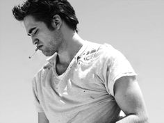 Rob Pattinson in a white t-shirt. With holes in it. Done. I'm done.