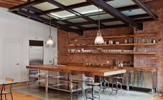 exposed brick and open shelving