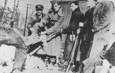 Ustasa (Croatian fascist) soldiers kill a victim with a dagger and bayonet. Yugoslavia, between 1941 and 1944.