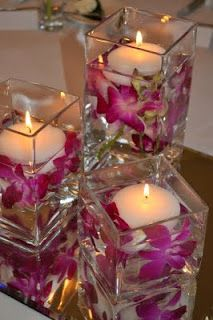 Square vases with floating candles and flowers