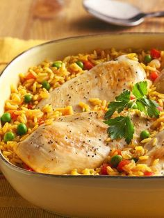 Arroz con Pollo. A one-dish dinner showcases moist, tender chicken on top of zesty, colorful rice.