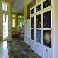 Chalkboard painted storage towers in family mudroom
