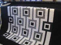 HELP!!  Can anyone tell me where to find this pattern???????  Black and White quilt by Charife